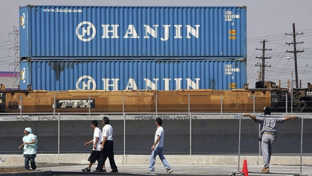 A train carries shipping containers from Hanjin
