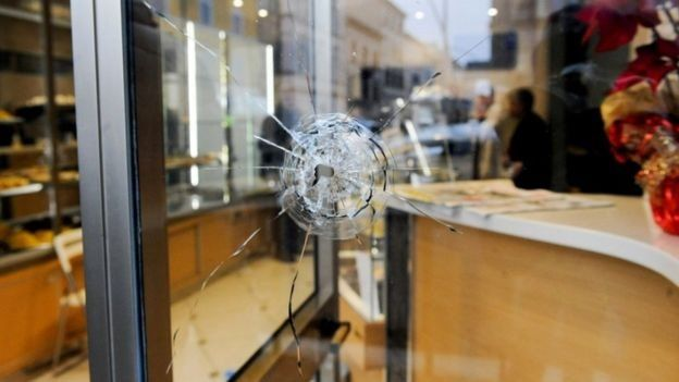 Bullet through window