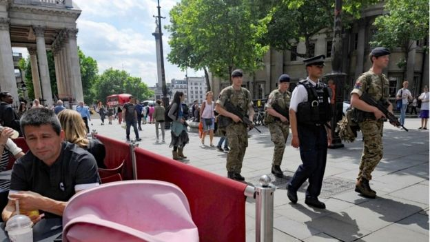 Troops join police officers on Whitehall, London