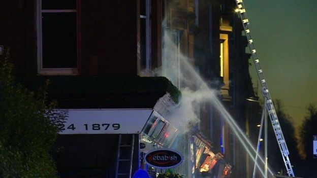Firefighters at the scene of the blaze on Victoria Road, Glasgow