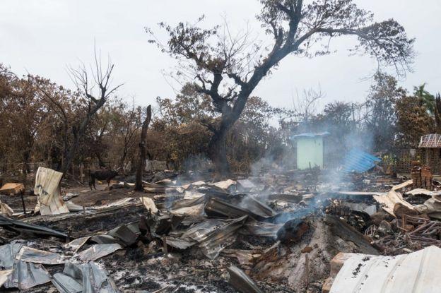 Beberapa minggu setelah serangan, Alel Than Kyaw masih mengepulkan asap.