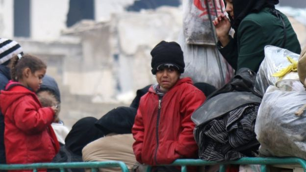 A child reacts while waiting with others to be evacuated from a rebel-held sector of eastern Aleppo, Syria 16 December 2016.