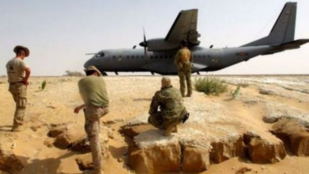 American trainers and Chadian soldiers next to a military plane
