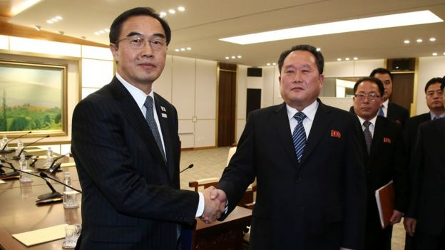 Head of the North Korean delegation, Ri Son Gwon shakes hands with South Korean counterpart Cho Myoung-gyon after their meeting at the truce village of Panmunjom in the demilitarised zone