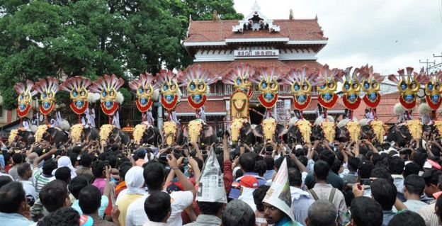 Thousands of Pooram fans watch the processions led by caparisoned elephants in Thrissur, in the southern Kerala state on May 1, 2012