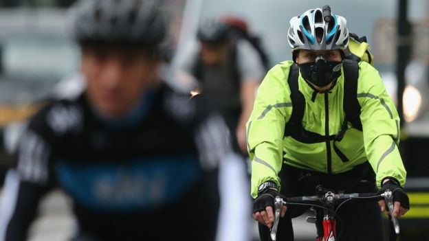 London cyclist wearing face mask