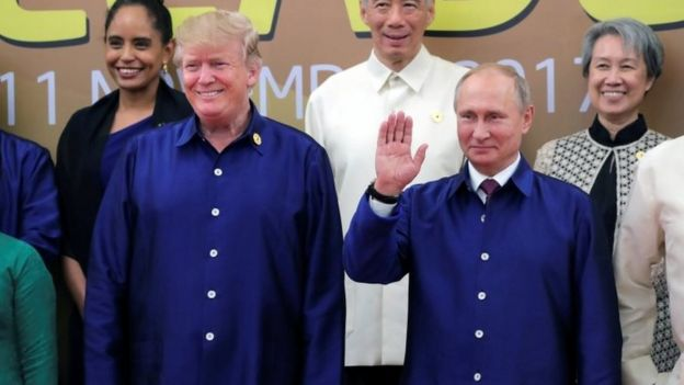 US President Donald Trump and Russian President Vladimir Putin take part in a family photo at the APEC summit in Danang, Vietnam, 10 November 2017