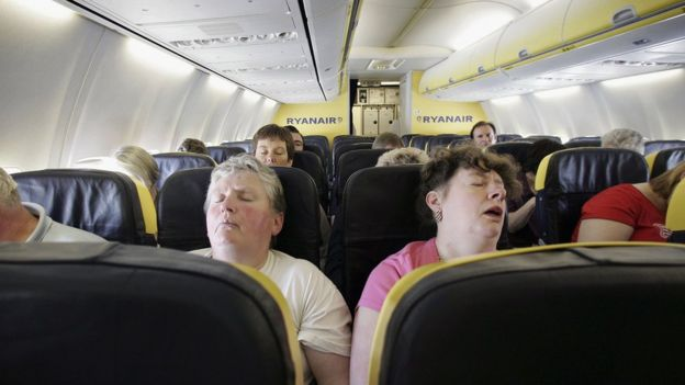 Passengers sleep in an airplane