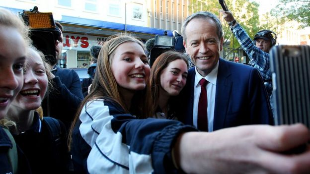 Opposition Leader Bill Shorten poses for a photo with fans on the campaign trail.