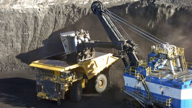 A mechanized shovel loads coal from an 80-feet thick seam into a haul truck at Cloud Peak Energys Spring Creek mine near Decker, Montana, November 2016