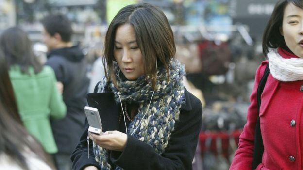 Young person on mobile phone in South Korea