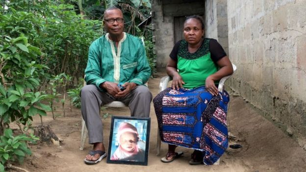 Barinaadaa Saturday and Chief Bira Saturday sit with a picture of their baby