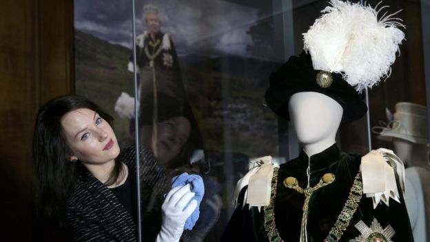 Largest exhibition of the Queen's clothes and accessories ever shown in Scotland will open at the Palace of Holyroodhouse