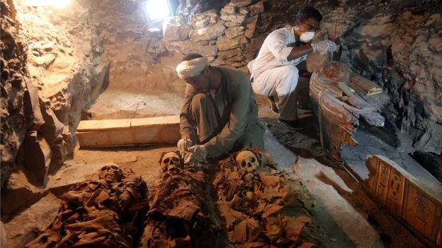 Egyptian archaeologists work on mummies at a recently discovered tomb in the Draa Abul Nagaa necropolis Luxor's West Bank 700km south of Cairo Egypt 9 September 2017
