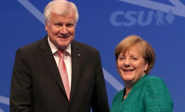 Horst Seehofer (L), Governor of Bavaria and leader of the Bavarian Christian Social Union (CSU), and German Chancellor and leader of the German Christian Democrats (CDU) Angela Merkel
