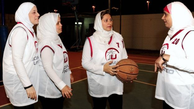 Saudi Lina al-Maaina (centre), coach and founder of the first Saudi female basketball team Jeddah United