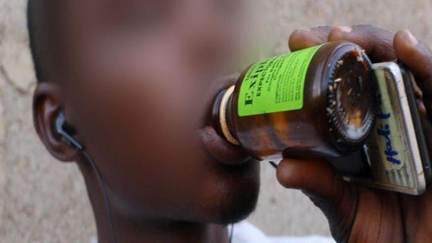 Young man dey drink codeine