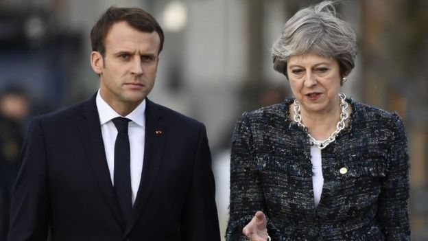 Theresa May speaking to Emmanuel Macron