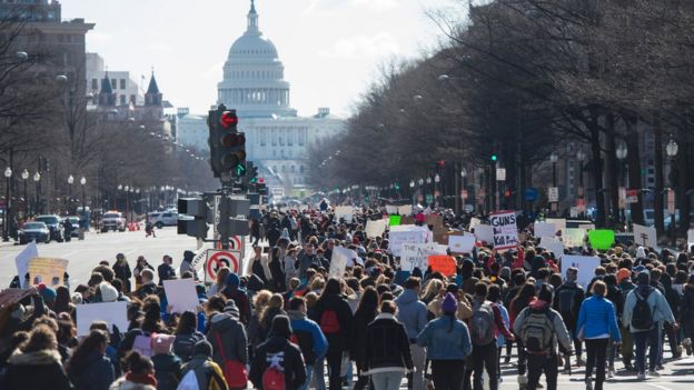 Thousands of students march down Pennsylvania Avenue from the White House to the US Capitol during a nationwide student walkout for gun control in Washington, DC, March 14, 2018