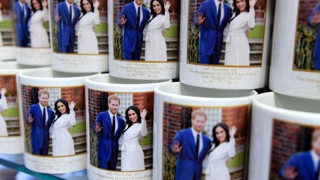 "Mugs marking the wedding of Britain""s Prince Harry and his fiancee Meghan Markle are on display at a souvenir shop in London,"