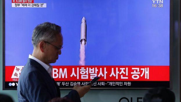 People watch a North Korea