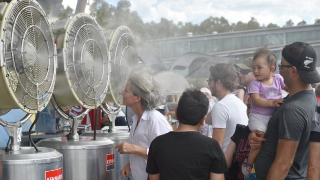Fans cool off in front of fans at the Sydney International tennis tournament earlier this month