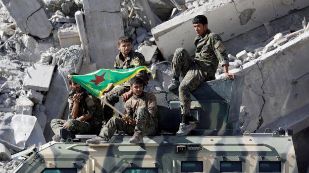Syrian Kurdish fighters in Raqqa on 17 October 2017