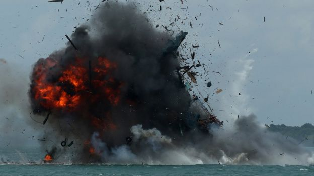 One of seven fishing boats is blown up by the Indonesian government in Batam, Kepulauan Riau province on February 22, 2016. Indonesia sank 27 impounded foreign boats on February 22, a minister said, as the world's largest archipelago nation stepped up a campaign against illegal fishing in its waters.