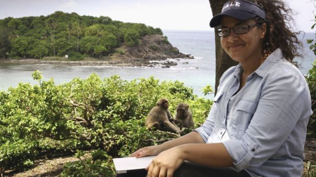 Laurie Santos studying monkeys.