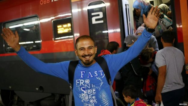 A migrant gestures at a train station in Vienna, Austria