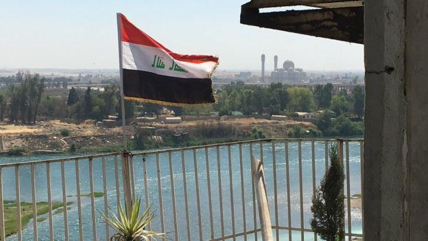 The Iraqi flag flying on the frontline on the banks of the River Tigris
