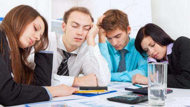 Grupo de trabajo cansado