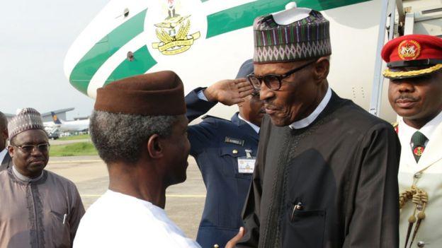 Nigerian President Muhammadu Buhari greeted by Vice President Professor Yemi Osinbajo