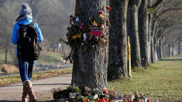 A woman walks past the spot where Maria L died