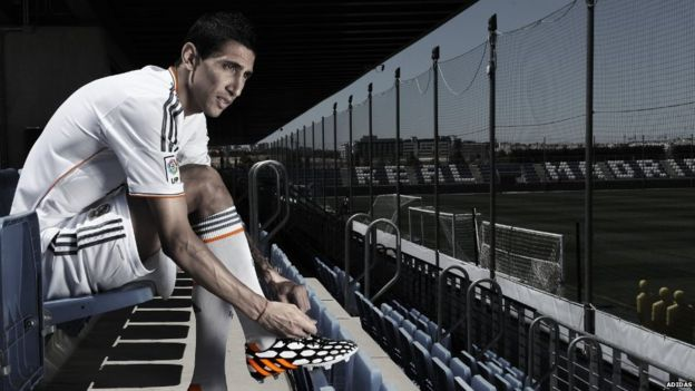 Angel Di Maria of Real Madrid tries on his adidas Predator Battle Pack boots