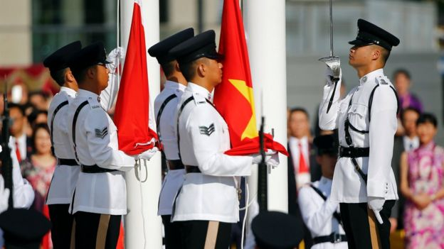The flags of China and Hong Kong are raised during a ceremony marking the 20th anniversary of the city's handover from British to Chinese rule, in Hong Kong, 1 July 2017