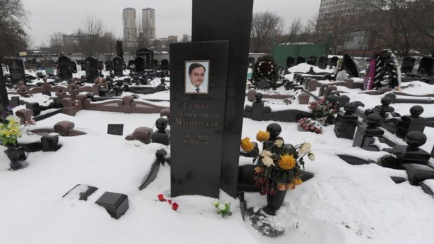 A picture taken on December 7, 2012, shows the snow-clad grave of Russian lawyer Sergei Magnitsky at the Preobrazhenskoye cemetery in Moscow.