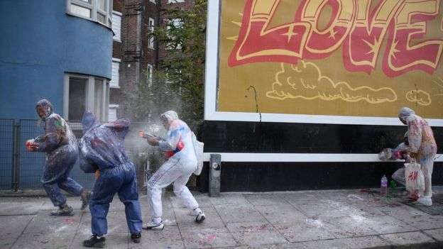Paint-covered revellers take part in the traditional
