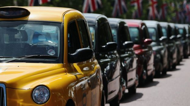 Line of black taxis