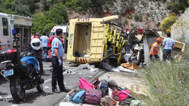 Medics and rescue workers stand at the scene after a tourist bus crashed near the southwestern holiday town of Marmaris