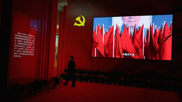2012年十八大前夕,一名北京群众在看党的成就展览