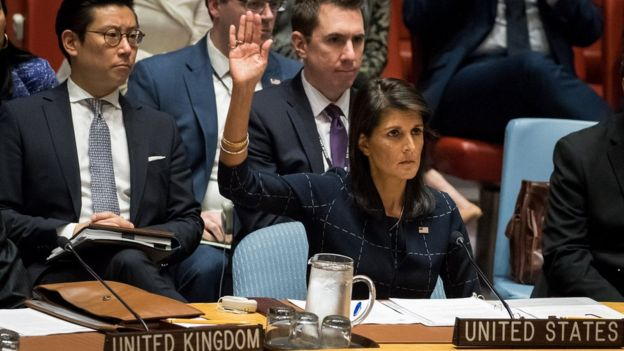 Nikki Haley, United States ambassador to the United Nations, raises her hand as she votes yes to levy new sanctions on North Korea designed to curb their nuclear ambitions during a meeting of the United Nations Security Council concerning North Korea at UN headquarters, 11 September 2017 in New York City.