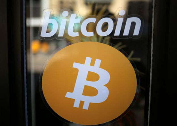 Bitcoin logo on shop window