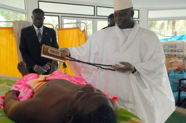 Yahya Jammeh waving the Koran over an HIV patient in 2007
