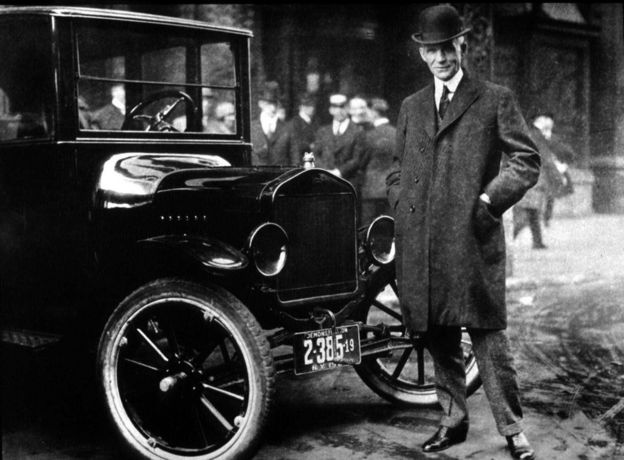 Henry Ford with one of his Model T cars, pictured in the 1930s