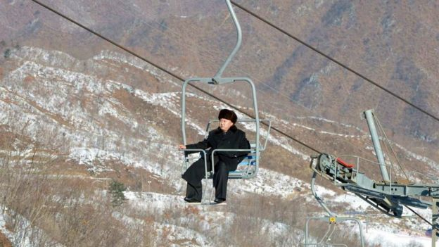 Kim Jong-un rides a ski lift at Masik ski resort in 2013 while smoking a cigarette