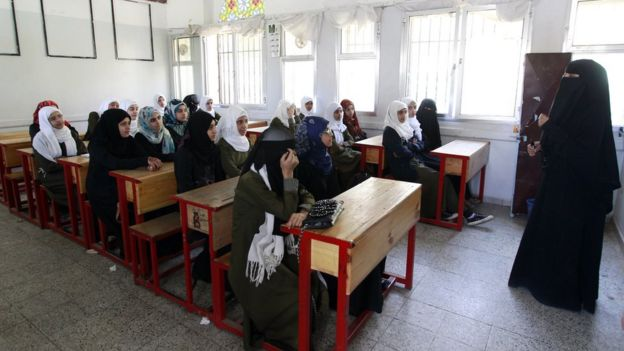 Yemeni girls listen to their teacher at a public school in Sanaa