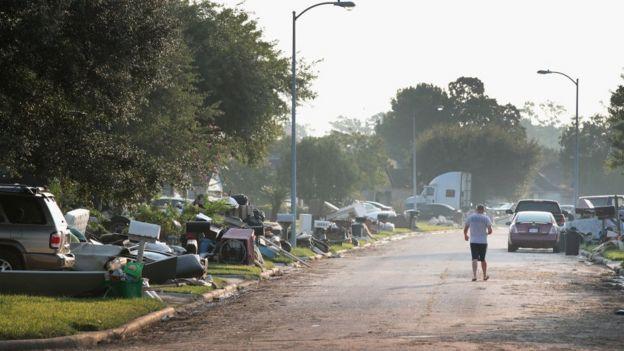 Homeowner clears debris