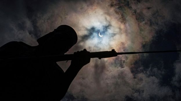 The eclipse is seen behind the Askari monument in Dar es Salaam, Tanzania.