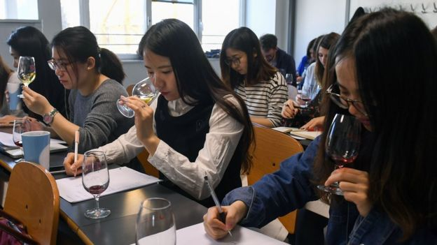 Chinese students taste and study wine during a class on March 16, 2017 at the School of Wine of the Dijon Business School.